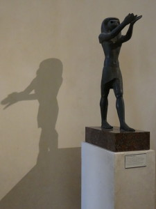 Louvre statue in shadow